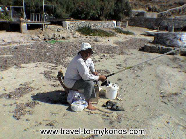 ORNOS BEACH - A fisherman on the work...