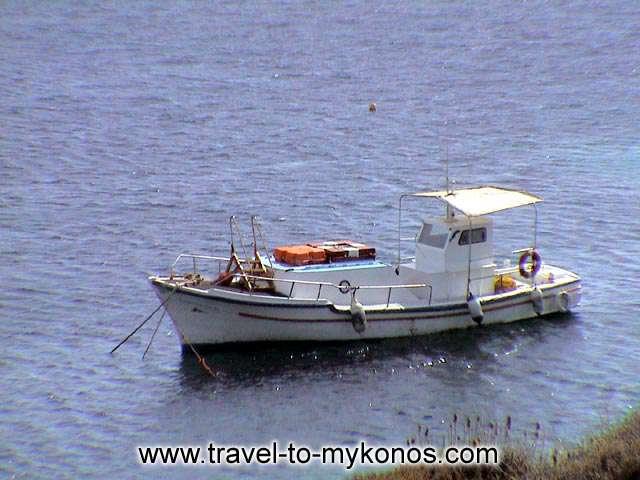 PSAROU BEACH - A fishing boat that has anchor near to the beach.