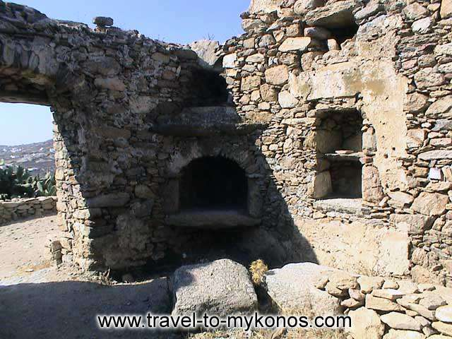 PALEOKASTRO - The ruins of the medieval castle of Gizi is found on the neighboring hill.