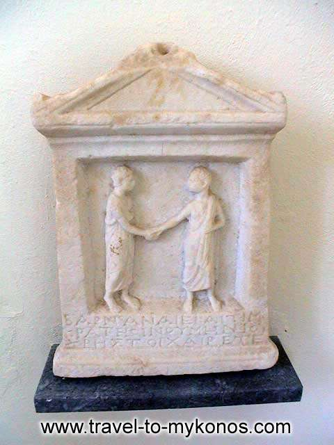 ARCHAEOLOGICAL MUSEUM - A grave stele that was found at Rheneia island.