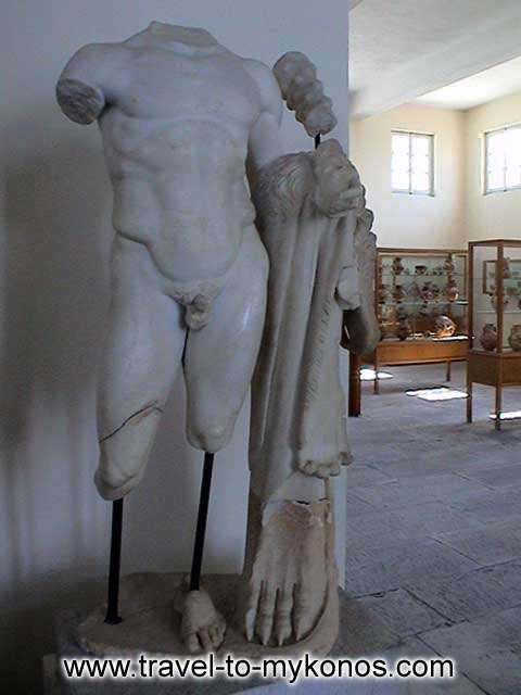ARCHAEOLOGICAL MUSEUM - The statue of Heracles from Rheneia. It is a hellenistic copy of a 5th-century. It was found in 1899 in the Sanctuary of Heracles.