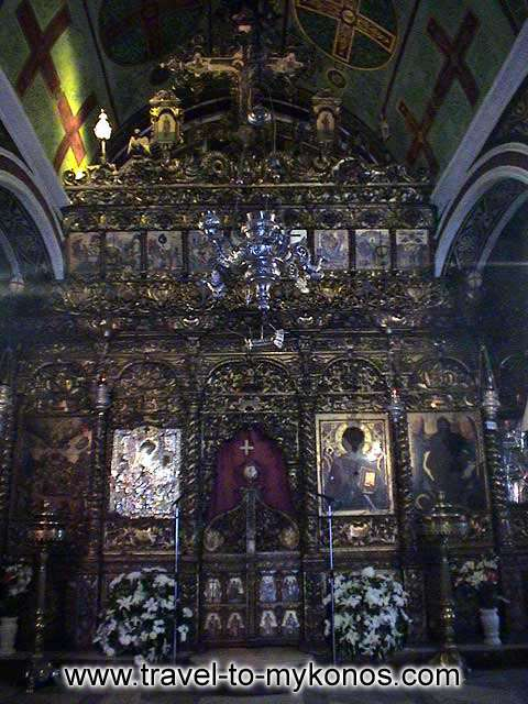 MONI TOURLIANIS - The splendid chancel screen of the church pulls the attention of pilgrims.