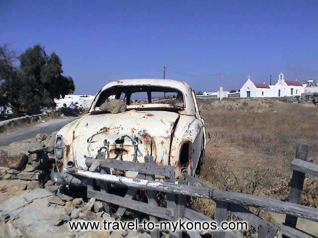 SPOT IN AIRPORT AREA - An old, forsaken car, in a region near to the airport.