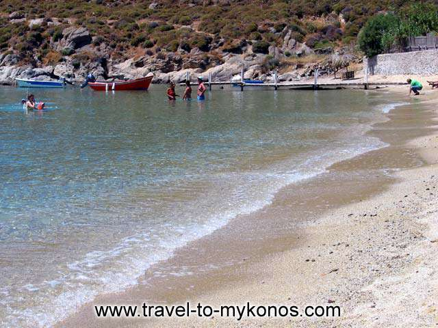 VIEW OF THE BEACH - A couple of boats and some people swimming in the wonderful beach of Psarou