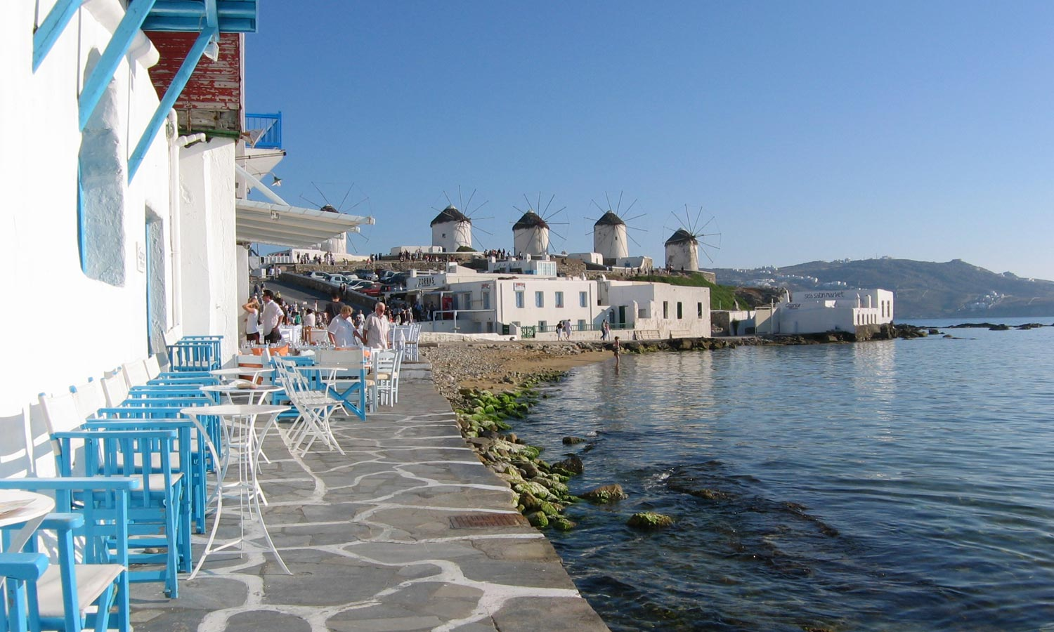View of the famous Mykonos windmills from Little Venice MYKONOS PHOTO GALLERY - Little Venice