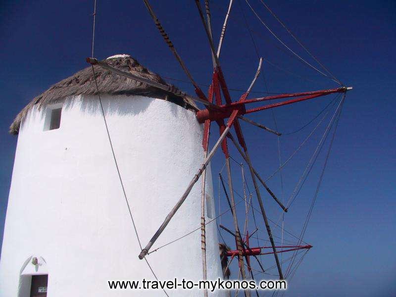 WINDMILL - Round, white, with the wooden conical roof windmill it reminds in the visitors passed seasons...