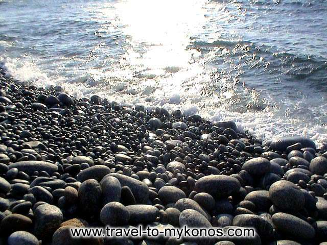 CHOULAKIA BEACH - The pebbles on Choulakia beach. It´s a natural monument of beauty. Small and picturesque attracts many tourists. The prehistoric pebbles on the beach are unique in Mykonos.