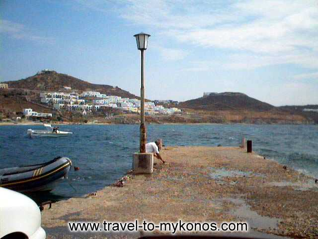 AGIOS IOANNIS BEACH - The sea wall of Agios Ioannis in which anchor the boats.