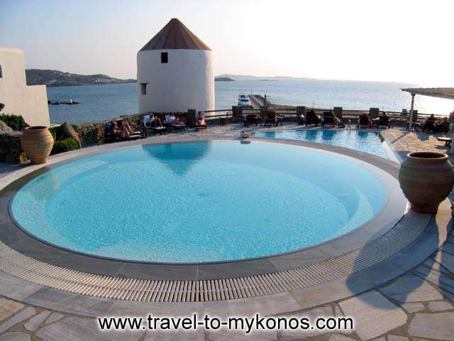 The hottest spot of Porto Mykonos Hotel is undeniably also the coolest. The pool is definitely the meeting point of our guests who seem incapable to resist its unique view and relaxing atmosphere. Situated on a large terrace, the Porto Mykonos pool will CLICK TO ENLARGE